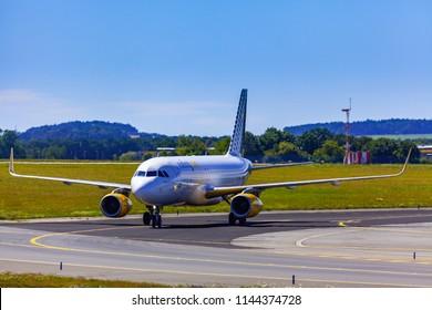 Prague, CZECH REPUBLIC - 07/07/2018: Landing and Arrivals on Vaclav Havel airport, Prague, Vueling Airbus A320-232, Spain