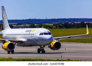 Prague, CZECH REPUBLIC,  - 07/07/2018: Landing and Arrivals on Vaclav Havel airport, Prague, Vueling Airbus A320-232, Spain