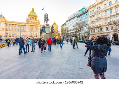 PRAGUE, CZECH REPUBLIC - 1.12.2018: The Wenceslas square (Vaclavske namesti in czech) statue near the national museum historical building. Old monument with tourist taking photos. National symbol