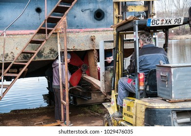 Prague, Czech Republic, 12 February 2018 repair of propeller and nozzle push ship on dry dock, man with welder
