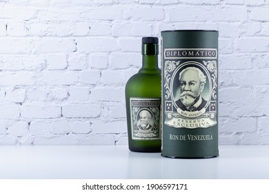 Prague, Czech Republic - 12 January 2021: Bottle of Diplomatico rum in front of white wall. The history of Diplomatico began in Venezuela in1959.