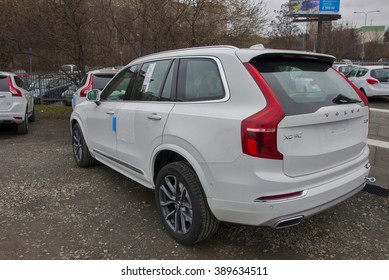 PRAGUE, THE CZECH REPUBLIC, 12.03.2016 - Bright new Volvo XC90 in front of car store Volvo in Prague