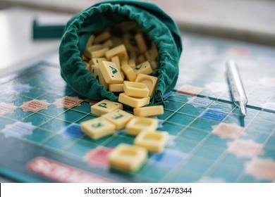 Prague, Czech Republic 13. March 2020: Word made from Scrabble game tiles. Scrabble letters spelling the message. Global Coronavirus virus crisis. Home entertainmentin quarantine for Coronavirus