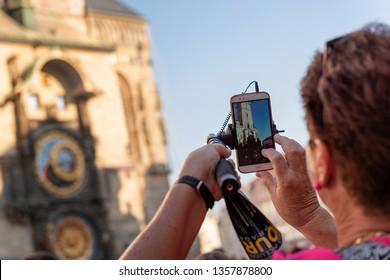 Prague, Czech Republic, 14 October 2018 - Tourist making photo for instagram on main square in Prague