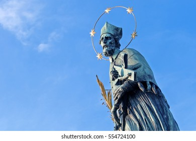 PRAGUE, CZECH REPUBLIC, 15 OCTOBER, 2015: Monument of the saint with nimbus and a crucifix  in his hands against the sky