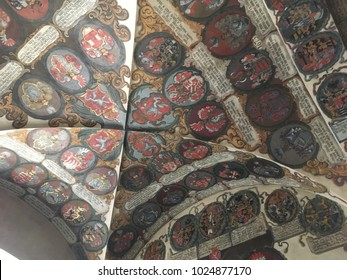 Prague, Czech Republic - 17 August 2017: Looking up at the ceiling of hand painted family crests inside the Old Prague Palace (Stary kralovsky palac) in Prague Castle complex.