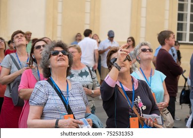 Prague, Czech Republic - 17 August 2017: A group of tourist looking up at St Vitus Cathedral in Prague on a summer day. Group of people sightseeing around Prague looking up at Saint Vitus Cathedral.