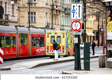 PRAGUE, CZECH REPUBLIC - 18 MARCH, 2017: Emergency ambulance rushing on the street with other road users. Traffic concept