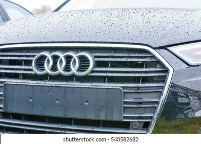 PRAGUE, THE CZECH REPUBLIC, 18.12.2016 - Front mask view of new black car Audi parked in front of Audi dealership.