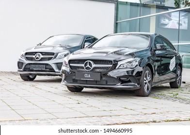 Prague, The Czech Republic, 1.9.2019: Luxury Mercedes Benz CLA white parked in front of car dealership Mercedes Benz.