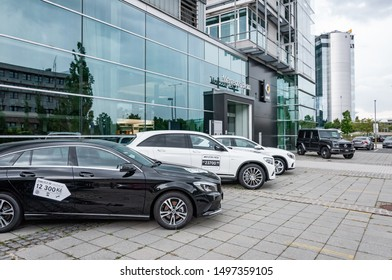 Prague, The Czech Republic, 1.9.2019: Luxury Mercedes Benz cars parked in row in front of car dealership Mercedes Benz. View to row of parked cars.