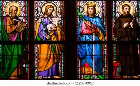 Prague / Czech Republic - 2017 07 01: Detail of art nouveau stained glass window by Alfons Mucha in St. Vitus Cathedral - Saints Luke, Joseph, Sigismund, Guilelmus