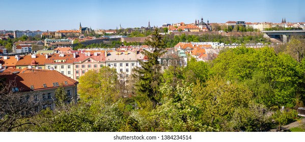 Prague, Czech Republic - 21.04.2019: Panoramic view of Prague Roofs, Zizkov television tower and the Nusle bridge (Nuselsky most), Vysehrad area in Prague in Czech Republic