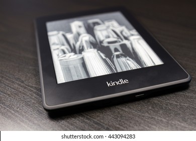 Prague, Czech Republic - 24 June 2016 - Amazon Kindle e-book reader on the black table