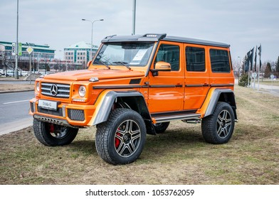 PRAGUE, THE CZECH REPUBLIC, 24.3.2018 - Front view Mercedes Benz G500 4x4 orange color in front of Car store Mercedes in Prague. G500 parked by the road