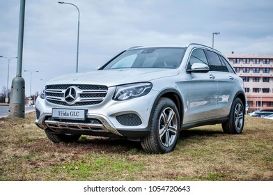 PRAGUE, THE CZECH REPUBLIC, 24.3.2018 - Front view Mercedes Benz GLC silver color in front of Car store Mercedes in Prague. GLC parked by the road