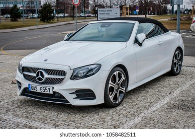 PRAGUE, THE CZECH REPUBLIC, 24.3.2018 - Front view of New luxury car Mercedes Benz E400 parking in front of Car store Mercedes, Prague. Luxury new car E400