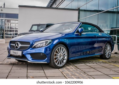 PRAGUE, THE CZECH REPUBLIC, 24.3.2018 - Front view Mercedes Benz C 220d blue color in front of Car store Mercedes in Prague. C200 coupe parking