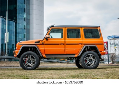 PRAGUE, THE CZECH REPUBLIC, 24.3.2018 - Mercedes Benz G500 4x4 orange color in front of Car store Mercedes in Prague. G500 parked by the road