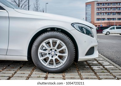 PRAGUE, THE CZECH REPUBLIC, 24.3.2018 - profile view Mercedes Benz C 200d white color in front of Car store Mercedes in Prague. C200 coupe parking and detail car wheel
