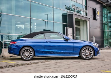 PRAGUE, THE CZECH REPUBLIC, 24.3.2018 - Profile view Mercedes Benz C 220d blue color in front of Car store Mercedes in Prague. C200 coupe parking