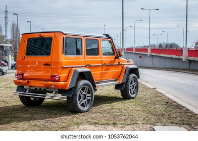 PRAGUE, THE CZECH REPUBLIC, 24.3.2018 - Rear view Mercedes Benz G500 4x4 orange color in front of Car store Mercedes in Prague. G500 parked by the road