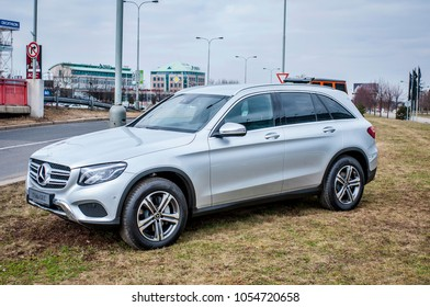 PRAGUE, THE CZECH REPUBLIC, 24.3.2018 - Side view Mercedes Benz GLC silver color in front of Car store Mercedes in Prague. GLC parked by the road