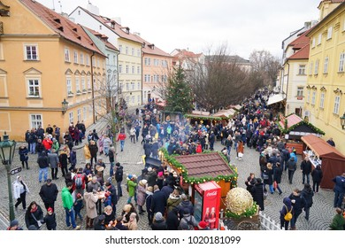 PRAGUE, CZECH REPUBLIC - 25 December 2017. Crowds of tourists exploring Pragues historic old town at Christmas