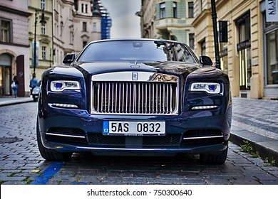 Prague, The Czech Republic, 28.9.2017: Closeup front view of blue Rolls-royce ghost car parking in the street.