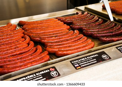 Prague, Czech Republic, 3 March 2019 : Grill czech sausages on on street food outdoor market. Fried baked sausages. European street food. Street food festival