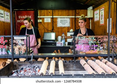 prague, czech republic. 3rd november 2018: famous trdelnik sweet roll cooking at shop