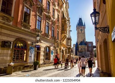 PRAGUE, CZECH REPUBLIC - 6 August 2018: Tourists Walking Towards Old Town Square and Prague Astronomical Clock Tower