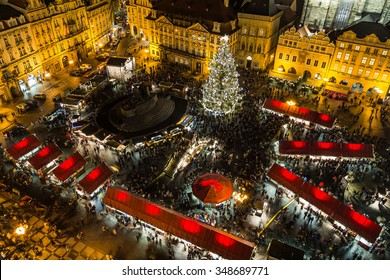 PRAGUE, CZECH REPUBLIC - 6TH DECEMBER 2015: A high view of the Christmas Market in Prague showing the market stalls, people and the tree.