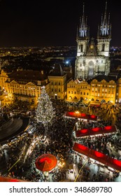 PRAGUE, CZECH REPUBLIC - 6TH DECEMBER 2015: A high view of the Christmas Market in Prague showing Church of Our Lady before Tyn, the market stalls, people and the tree.