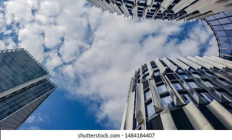 Prague, The Czech Republic, 8.4.2019: Closeup of skycraper business center. Glass business center with blue sky. windows of modern office centre.
