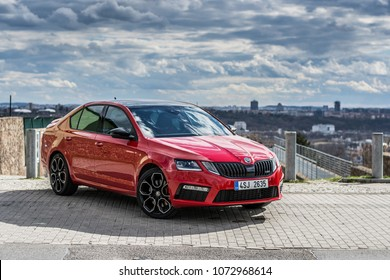 PRAGUE, THE CZECH REPUBLIC, 9. 4. 2018: New Skoda Octavia RS 245, model year 2018 in Czech with view on Prague