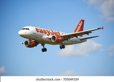 PRAGUE, CZECH REPUBLIC - April 01, 2012: EasyJet Airline Airbus A319 lands to PRG Airport in Prague. EasyJet is the second-largest low-cost carrier in Europe, behind Ryanair.