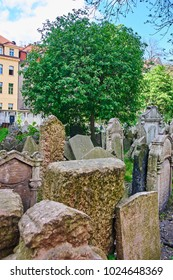 PRAGUE, CZECH REPUBLIC - APRIL 09, 2009: Tombstones on Old Jewish Cemetery in the Jewish Quarter in Prague.There are about 12000 tombstones presently visible