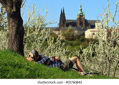 PRAGUE, CZECH REPUBLIC, April 10. 2011: People enjoying sunny weather, spring and blooming trees at Petrin hill on April 10. 2011 in Prague, Czech Republic
