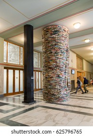 PRAGUE, CZECH REPUBLIC – APRIL 11, 2017: Artwork Idiom consisting of books and mirrors by sculptor Matej Kren in the Municipal Library of Prague on Marianske Square in Prague.