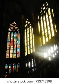 PRAGUE, CZECH REPUBLIC - APRIL 11, 2009: Sunlight streams through stained glass windows at St. Vitus Cathedral in Prague.