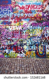 PRAGUE, CZECH REPUBLIC - APRIL 12: The Lennon Wall since the 1980s is filled with John Lennon-inspired graffiti and pieces of lyrics from Beatles songs on April 12, 2013 in Prague, Czech Republic