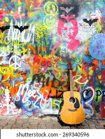 PRAGUE, CZECH REPUBLIC - APRIL 14, 2015: The Lennon Wall since the 1980s is filled with John Lennon-inspired graffiti and pieces of lyrics from Beatles songs on April 14, 2015 in Prague.