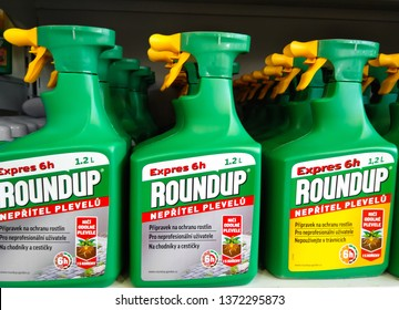 PRAGUE, CZECH REPUBLIC - APRIL 19, 2019: Shelves with containers of RoundUp herbicide. More than 11,000 lawsuits in the U.S. seek to link the herbicide to cancer.
