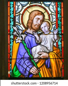 Prague, Czech Republic - April 2, 2016: Stained Glass window in St. Vitus Cathedral, Prague, depicting Saint Joseph and the Child Jesus