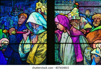 PRAGUE, CZECH REPUBLIC - APRIL 2, 2016: Stained Glass window in St. Vitus Cathedral, Prague, designed by Alphonse Mucha, depicting Saint Methodius carrying the casket of Saint Cyril.