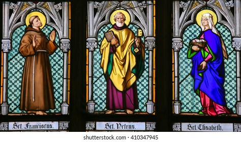 PRAGUE, CZECH REPUBLIC - APRIL 2, 2016: Stained Glass window in St. Vitus Cathedral, Prague, depicting Saint Francis, Saint Peter and Saint Elisabeth