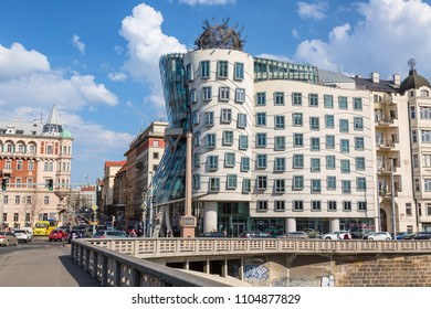 Prague, Czech Republic - April, 2018: Dancing house Ginger and Fred in Prague, Czech Republic during summer day with blue sky and clouds. Famous landmark in Prague