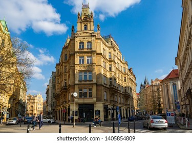 Prague, Czech Republic - April 2019: Outdoor sunny view of typical architectural European style around roundabout near Holy Ghost Church, Kafka Monument and Spanish Synagogue in summer season
