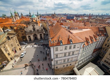 PRAGUE, CZECH REPUBLIC - APRIL 25, 2017: Ultra wide panoramic view of old town square with The Church of St. Francis, Klementinum